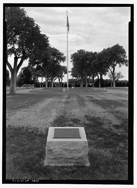BIVOUAC OF THE DEAD PLAQUE AND FLAG POLE.  VIEW TO SOUTH.   - Fort Lyon National Cemetery, 15700 Country Road HH, Las Animas, Bent County, CO