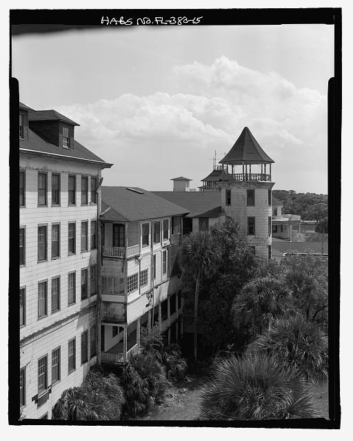 FRONT, PORTION OF NORTH WING, CENTRAL STRUCTURE PORCHES AND COPULA: CAMERA DIRECTION SOUTH - Ormond Hotel, 15 East Granada, Ormond Beach, Volusia County, FL