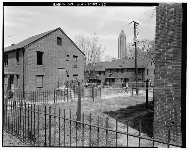 "22.  In context, from southwest facing northeast, typical courtyard formed by ""U"" building configuration, south side of Building E-3, left. - Clark Howell Homes (Public Housing), Bounded by North Avenue, Lovejoy Street, Mills Street & Luckie Street, Atlanta, Fulton County, GA"