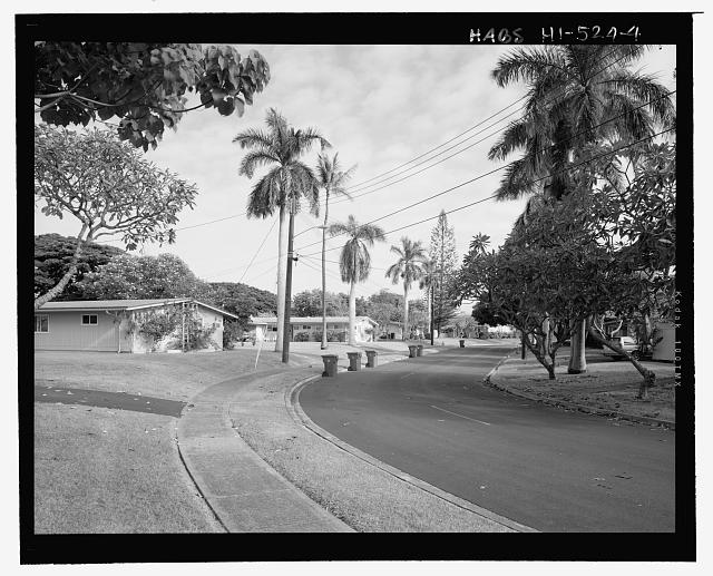 VIEW OF DATE DRIVE, SHOWING ROYAL PALMS ALONG THE STREET. VIEW FACING EAST - Camp H.M. Smith and Navy Public Works Center Manana Title VII (Capehart) Housing, Intersection of Acacia Road and Brich Circle, Pearl City, Honolulu County, HI