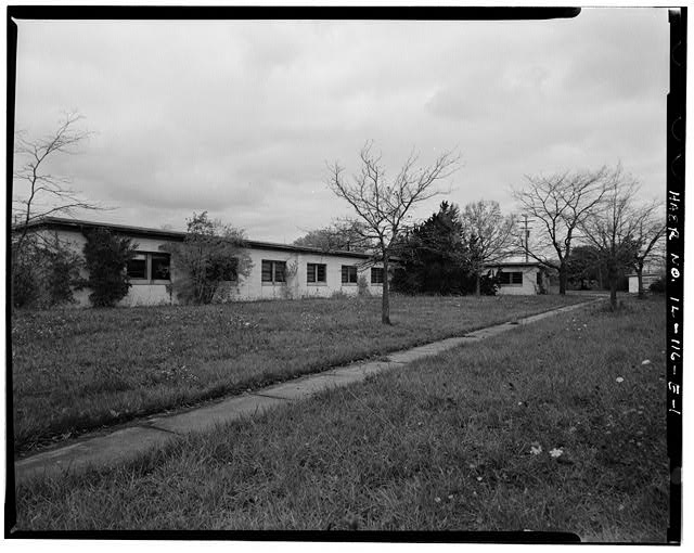 1.  BARRACKS, SHORTER BUILDING, FRONT, LOOKING NORTHWEST. - NIKE Missile Base C-84, Shorter Barracks, South of Launch Area Entrance Drive, west of Longer Barracks, Barrington, Cook County, IL