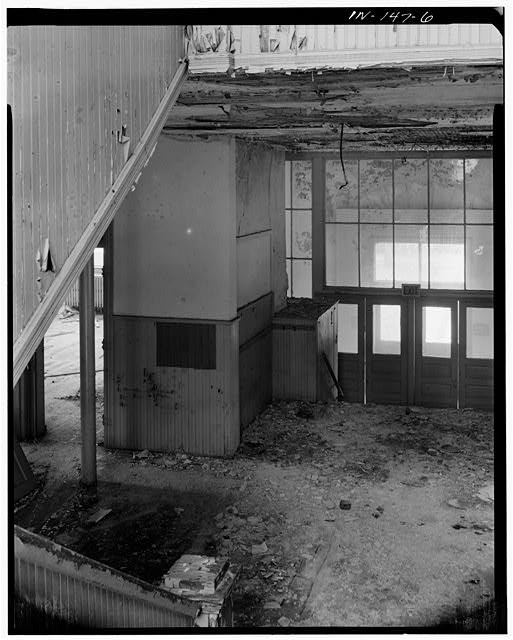 6.  STAIR LANDING LOOKING TO FIRST FLOOR FOYER AND ENTRANCE - Riley School, Seventh & College Streets, Mitchell, Lawrence County, IN