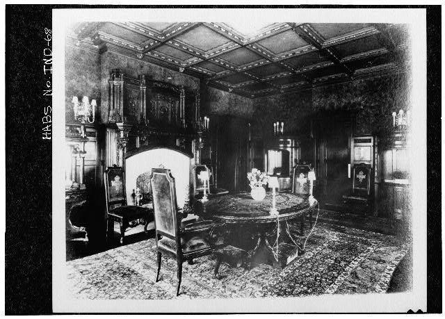 6.  Historic American Buildings Survey PHOTOCOPY CA. 1916 OF DINING ROOM, LOOKING NORTHWEST. ORIGINAL VELOUR IS STILL ON WALLS AND IN GOOD CONDITION. CARVINGS ON FIREPLACE FEATURE A FRUIT MOTIF. FLOORS PARQUET Original in Collections of Marian College - James A. Allison Mansion, 3200 Coldspring Road, Indianapolis, Marion County, IN