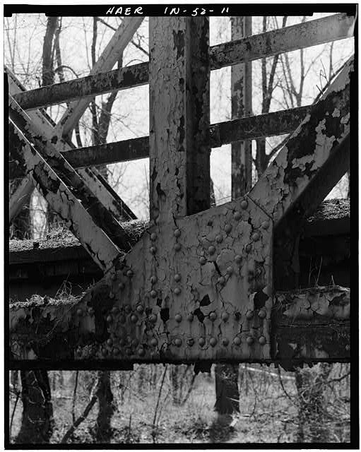 11.  DETAIL VIEW OF TRUSS ATTACHED TO DECK AND DECK BEAM - Hamilton County Bridge No. 218, Greenfield Pike, spanning Stoney Creek, Noblesville, Hamilton County, IN