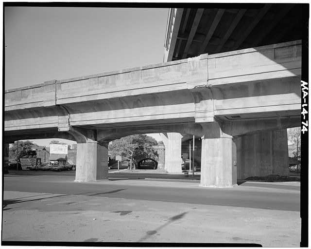 74.  East elevation of elevated Mainline structure (Section F-6) looking West - along the Arborway toward the masonry bridge carrying the former New Haven R.R. tracks over the Arborway. Arborway overpass is at upper right. - Boston Elevated Railway, Elevated Mainline, Washington Street, Boston, Suffolk County, MA