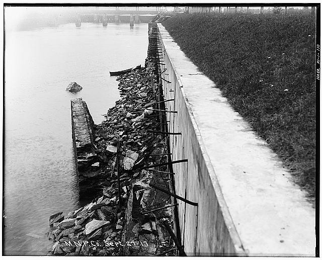 110.  Photocopied August 1978. REPAIRED SIDE WALL, NORTH SIDE, EAST OF RAILROAD BRIDGE, SEPTEMBER 27, 1917, SHOWING THE POURED CONCRETE WALL WHICH REPLACED THE EARLIER MASONRY AND STONE WALLS. MUCH OF THE MATERIAL WHICH HAD SLID INTO THE CANAL WAS NOT REMOVED UNTIL 1926. (839) - Michigan Lake Superior Power Company, Portage Street, Sault Ste. Marie, Chippewa County, MI