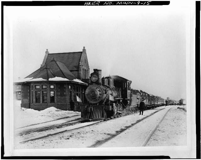 15.  Photocopy of photograph, ca. 1910. DULUTH & IRON RANGE RAILROAD LOCOMOTIVE #46 (BUILT IN 1888) WITH LOG TRAIN AT ENDION DEPOT. (Original print property of Edward Schafer Associates, Inc., Duluth, Minnesota) - Endion Passenger Depot, 1504 South Street, Duluth, St. Louis County, MN