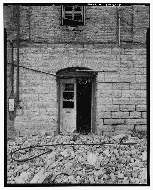 13.  NORTH SIDE, DETAIL OF DOORWAY NEAR NORTHEAST CORNER; LOOKING SOUTH - Crown Roller Mill, 105 Fifth Avenue, South, West Side Milling District, Minneapolis, Hennepin County, MN