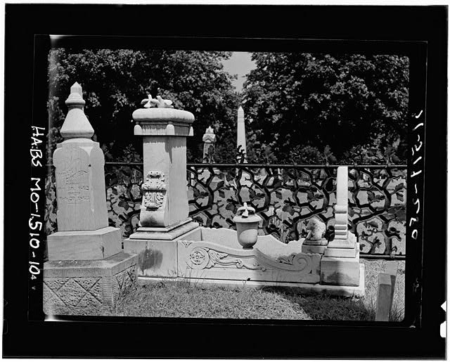 10.  GRAVE COVER AND MONUMENT, WITH ANOTHER STONE IN PICTURE - Cemetery, Lexington, Lafayette County, MO