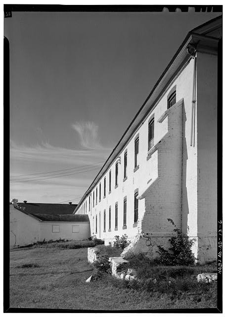 5.  REAR SECTION WITH STEPPED BUTTRESS FROM NORTH - Fort Totten, Company Barracks, Building No. 11, 12 miles southwest of Devils Lake City off Route 57, Devils Lake, Ramsey County, ND