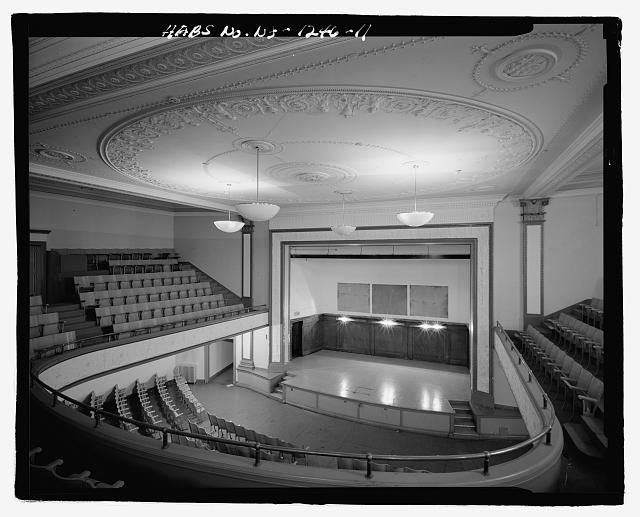 AUDITORIUM LOOKING TOWARD STAGE, BLANK WOODEN PANELS AT BACK OF STAGE MARK WHERE WPA MURALS WERE LOCATED - Thirteenth Avenue School, 131 Thirteenth Avenue, Newark, Essex County, NJ