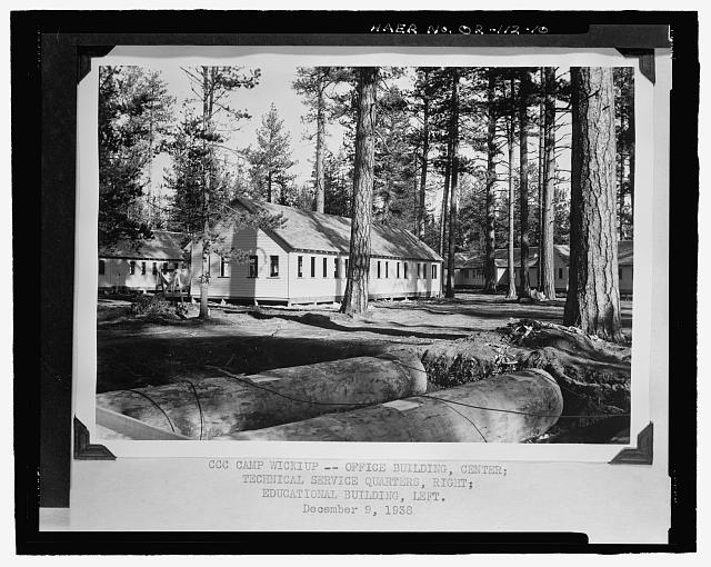 CCC CAMP WICKIUP – OFFICE BUILDING, CENTER; TECHNICAL SERVICE QUARTERS, RIGHT; EDUCATIONAL BUILDING, LEFT. Photocopy of historic photographs (original photograph on file at National Archives, Rocky Mountain Region, Denver, CO). Unknown USBR Photographer, December 9, 1938 - Wickiup Dam, Deschutes River, La Pine, Deschutes County, OR