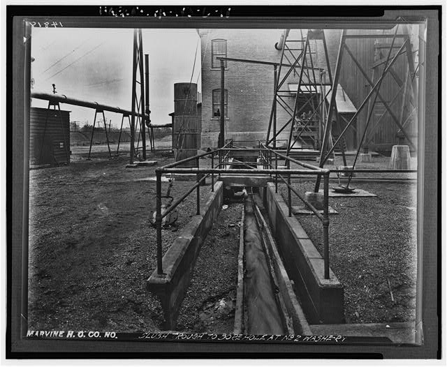 18.  Photocopy of photograph. Horgan, date unknown. Original negative can be found in D & H collection of the Anthracite Heritage Museum, Scranton, Pennsylvania. DETAIL VIEW OF SLUSH TROUGH FROM BREAKER NO. 2 TO BOREHOLE UNDER NORTH END OF BOILER HOUSE NO. 2, LOOKING SOUTH - Marvine Colliery, Breaker No. 2, West side Boulevard Avenue, between East Parker Street & Route 380, Scranton, Lackawanna County, PA