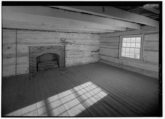 18.  Interior view of south room, looking to southwest corner, with scale to left (east) of fireplace; view includes the window in the west wall, white washed ceiling joists and log walls, and the brick fireplace & hearth - The Hermitage, West Cabin, 4580 Rachel's Lane, Hermitage, Davidson County, TN