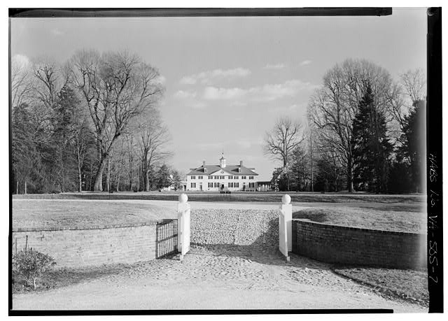 7.  VIEW FROM THE NORTHWEST, SHOWING GATES IN FOREGROUND AND HOUSE AT REAR ACROSS GROUNDS - Mount Vernon, Mount Vernon Memorial Highway, Mount Vernon, Fairfax County, VA