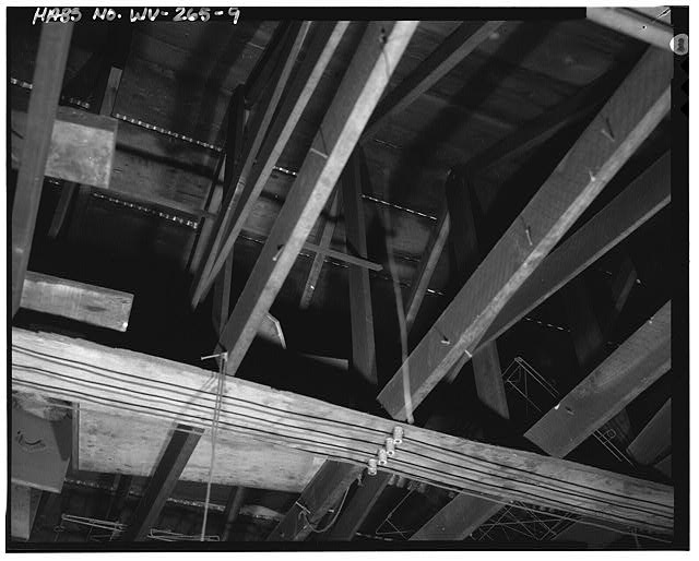 9.  Attic, looking up, showing truss system and electrical wiring - Campbells Creek Coal Company Store, 54 Port Amherst Drive, Campbells Creek vicinity, Charleston, Kanawha County, WV