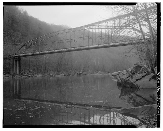 1. View northwest, main Pennsylvania Petit truss span (note New River Gorge Bridge in background). - Fayette Station Bridge, Spanning New River at County Route 82, Fayetteville, Fayette County, WV