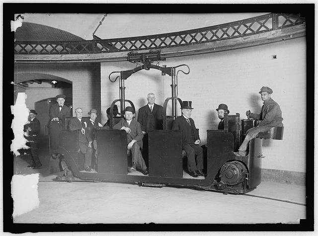 O'GORMAN, JAMES ALOYSIUS. SENATOR FROM NEW YORK, 1911-1917. 3RD FROM RIGHT, RIDING MONORAIL CAR