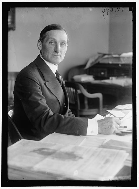 McADOO, WILLIAM GIBBS. SECRETARY OF THE TREASURY, 1913-1921. AT DESK