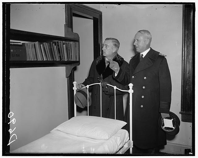 Assistant Secretary inspects Naval Academy. Annapolis, Md. Visiting the Naval Academy for the first time since his appointment, Assistant Secretary Charles Edison Inspects a Midshipman's quarters with Rear Admiral David F. Sellers, Commandant of the Academy