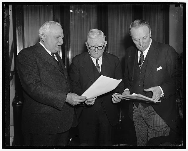 "Scan president's message on Judiciary. Washington D.C. No President's message in years has created the interest the one President Roosevelt sent to Congress today, demanding an overhauling of the Judiciary. Vice President Garner (center) with Senator William H. Dietrich (left) of Illinois; and Senator Henry F. Ashurst of Arizona, Chairman of the Senate Judiciary Committee, studying the message shortly after It reached Congress. The only comment Senator Ashurst would make was ""President Taft urged this same thing several years ago"" he added he would make a full statement later"