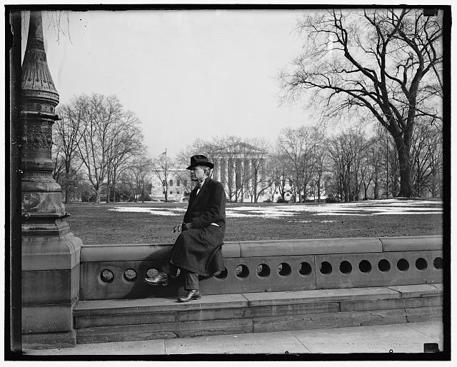 Idaho Senator ponders. Washington D.C. The cameraman catches Senator William E. Borah, veteran Idaho legislator, as he rests after a stroll though the Capitol grounds today. With the Supreme Court in the background Senator Borah picked a good spot to ponder the President's latest message to Congress demanding a face-lifting for the Judiciary. Republican member of the Senate Judiciary Committee, Senator Borah is almost certain to lead the fight against the scheme