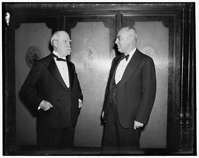 Chief Justice makes public appearance. Washington, D.C., March 15. Chief Justice Charles Evans Hughes, left: made one of his few public appearances last night when he attended the Alumni dinner of Brown Universtiy at the Mayflower Hotel here, he introduced Henry M. Wriston, the newly inaugrated President of Brown University, right; Mr. Hughes graduated Brown in 1881