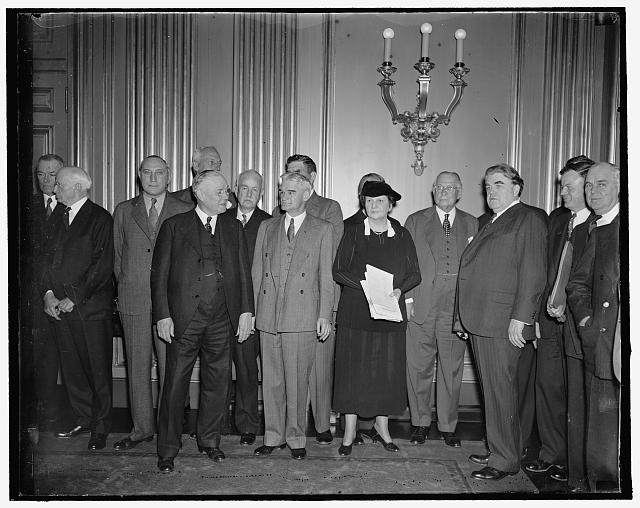 Labor peace plan sought. Washington, D.C., April 20. Leaders of labor and industry attended a conference today with Secretary of Labor Perkins in efforts to effect a National policy to avert strikes and lockouts. In the photograph, left to right: D.W. Tracy, President of Brotherhood of Electrical Workers; Harper Sibley, President of the U.S. Chamber of Commerce; William Green, President of the U.S. Chamber of Commerce; Ray Ingersoll, former Arbitrator of the Cloak and Suit Industry; R.C. Whiting, President of Fuller Construction Co.; Secretary Perkins; Clarence Wooley, President of the American Radiator Co.; John L. Lewis, Head of C.I.O.; and J. Warren Madden, Chairman of National Labor Relations Board, 4/20/1937