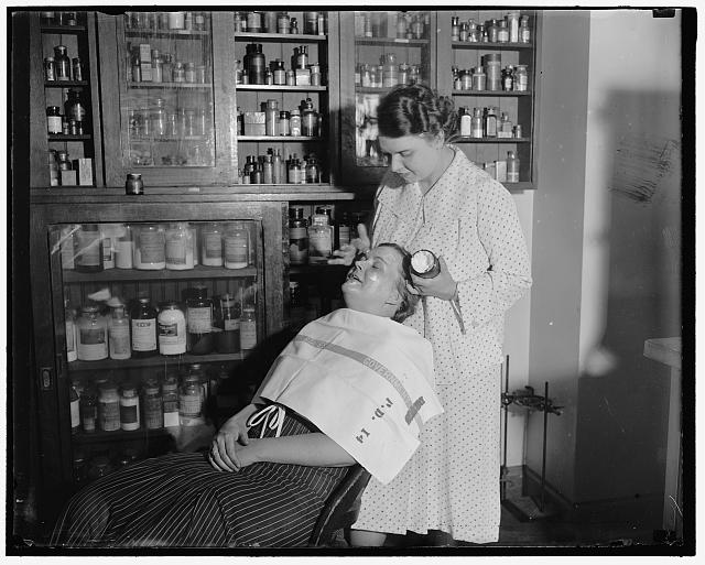 Testing cosmetics. Washington D.C. July 10. The department of Agriculture is making tests everyday in order to get cosmetics under the Pure Food and Drug Act, Mrs. C.W. West seated is helping Mrs. R. Goodman make a test on cold cream and other facial creams.