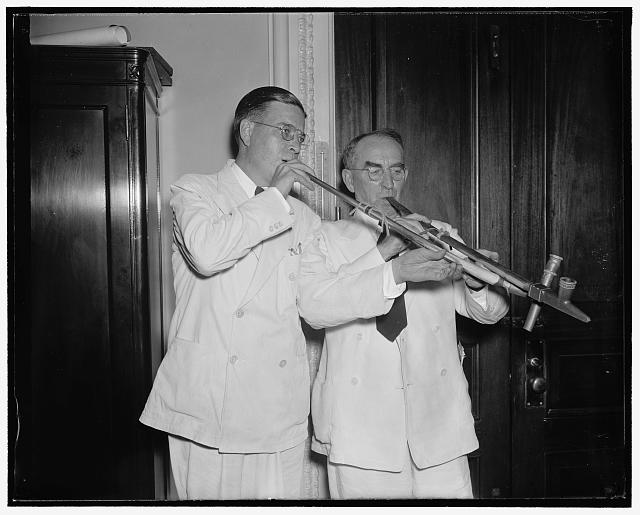 Politics forgotten. Washington D.C. Aug 21. Past political battles were forgotten tonight for Speaker Bankhead and Rep. Paul J. Kvale, Farmer-Labor Salon from Minnesota, when they joined in the pipe pf peace as the curtain on first session of 75th Congress was rung down. 8/21/37