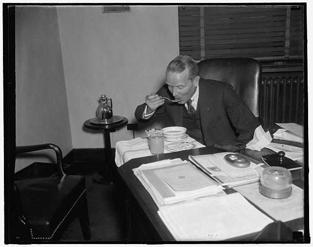 Acting maritime head busy official. Washington, D.C., Dec. 20. So busy these days is Admiral Emory S. Land, acting Head of the U.S. Maritime Commission, that he generally has lunch served at his desk every day. Land is pinch-hitting for Chairman Joseph P. Kennedy who vacationing in Florida. Reports say that Land will succeed to the Chairmanship in the event Kennedy is nominated as Ambassador to Great Britain, 12/20/37