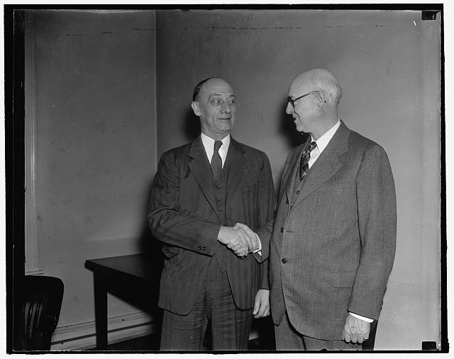 FTC chairmanship changes hands. Washington, D.C., Jan. 3. Commissioner William A. Ayres (right) today relinquished the Chairmanship of the Federal Trade Commission to Commissioner Garland S. Ferguson, who was elected last week. The FTC Chairmanship rotates yearly, 1/3/38