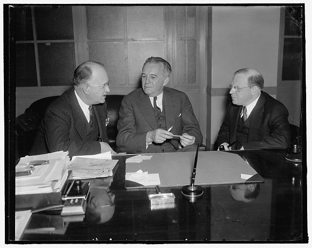 "National Mediation Board. Washington, D.C., Jan. 10. A new photograph of the National Mediation Board whose members are responsible for administrating the ""Railway Labor Act"" left to right they are: George A. Cook, Secretary; O.S. Beyer; and William M. Leiserson, member, 1/10/38"