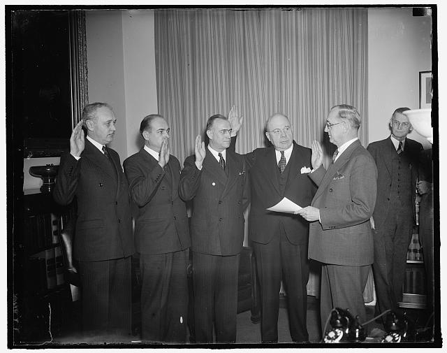 New Treasury appointees take oath. Washington, D.C., Jan. 15. Today was swearing-in day at the Treasury as four newly appointed Treasury aides took the oath of office. In the photograph, left to right: Goodwin J. Oppegard, to be Deputy Comptroller of the Currency; Gibbs Lyons, to be Chief National Bank Examiner of the 6th Federal Reserve District; Marshall R. Diggs, to be Chief Supervising Receiver and 1st Deputy Comptroller of the Currency; and William Prentiss, Jr., to be Chief National Bank Examiner of the 12th Federal Reserve District, and F.A. Birgeld, Chief Clerk of the Treasury Department who did the swearing in, 1/15/38