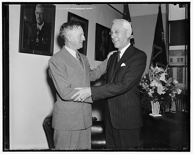 Congratulations! Washington, D.C., March 26. Mutual congratulations were exchanged today as Maj. Gen. John K. Kerry (left) became U.S. Chief of Calvary, and Maj. Gen. R.M. Danford assumed the post of Chief Field Artillery. The officers are personal friends of long standing, 3/26/38