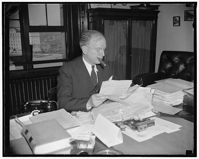Reads protest against Government Reorganization Bill. Washington, D.C., March 28. Montana's Senator Burton K. Wheeler found his desk stacked high with telegraphic protests against the Government Reorganization Bill when he arrived at his office in the Capitol today, 3/28/38