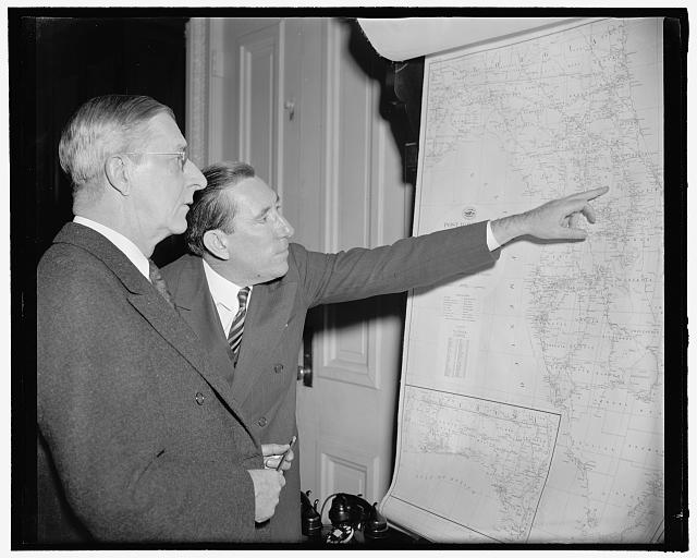 Florida ship canal again brought up. Washington, D.C., Feb. 8. One of the president's favorite projects, the Florida Ship Canal, was the subject of a meeting of the Commerce Committee of the Senate today at the request last week of the President. Senator Claude Pepper, Florida, traces the route of the unfinished canal to Chairman Josiah Bailey, Senator from North Carolina, 2-8-39