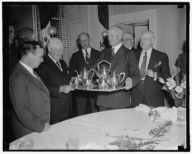 Former house minority leader presented set of silver by republican congressmen. Washington, D.C., April 5 -Former House Minority Leader Bertrand N. Snell, or New York, was presented with a silver service set at surprise breakfast tendered him today at the Capitol by his former republican colleagues. In the photo - left to right - House Minority Leader Joseph W. Martin, Jr. of Massachusetts - Bertrand N. Snell - Rep. James W. Wadsworth of New York - Rep. Daniel A. Reed of New York and Rep. Frank Crowther of New York. 4-5-39