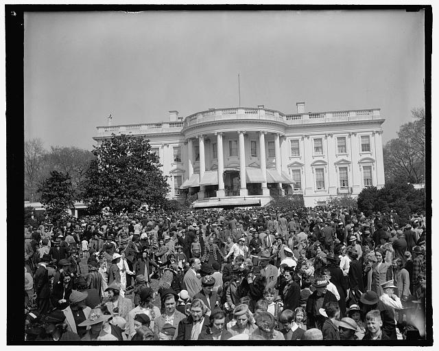 Youngsters jam White House lawn to roll Easter eggs. Washington, D.C., April 10. General view of the thousands of Youngsters who today took part in the traditional Easter egg rolling on the historic White House lawn. President and Mrs. Roosevelt greeted the children from the south portico. 4-10-39