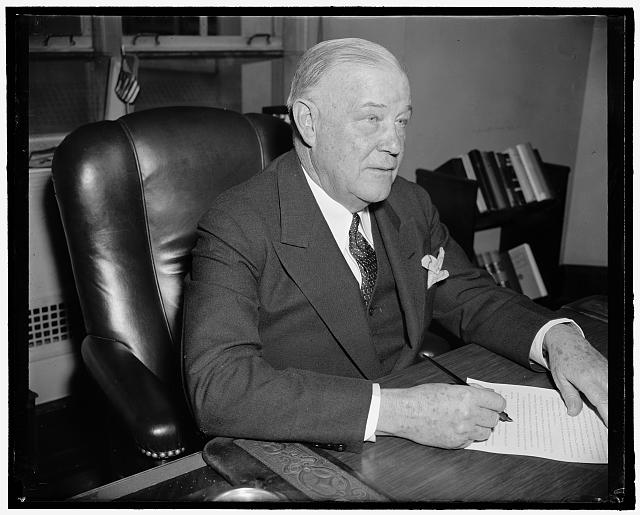 New FCC Commissioner. Washington, D.C., April 13. Frederick I. Thompson, recently named a member of the Federal Communications Commission, photographed at his desk today shortly after taking over his new duties, 4-13-39