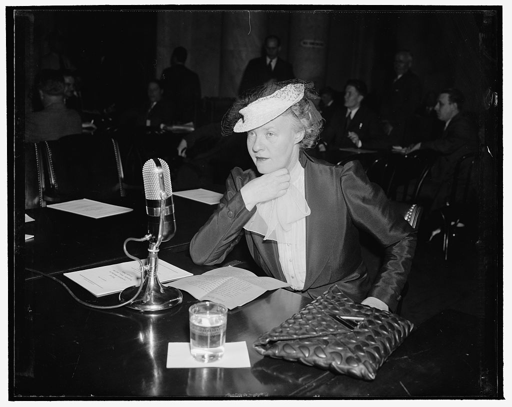 Dorothy Thompson, columnist, sat down before Foreign Affairs Chairman Key Pittman and told him and members that neutrality laws should be repealed to allow the country to be free in forming policies in foreign affairs. Photograph by Harris and Ewing.