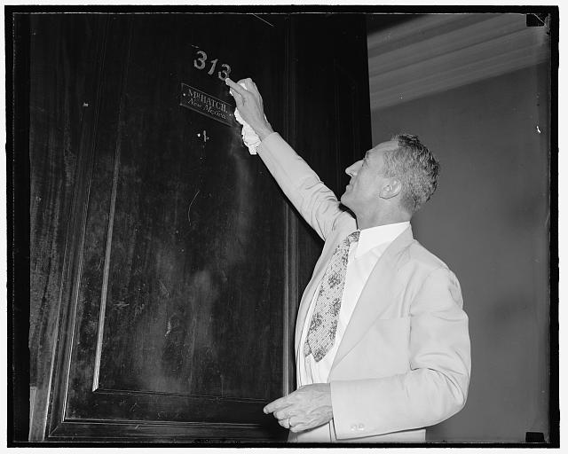 "Number 13 proves lucky for New Mexico senator. Washington, D.C., July 26. Senator Carl A. Hatch, Democrat of New Mexico, polishing up his lucky 13 office number. He is one of the few Senators who have succeeded in getting a major bill through both Houses of Congress practically intact this session. ""Luck? Yes, there is an element of luck in getting through a bill"", he said, 7/26/39"