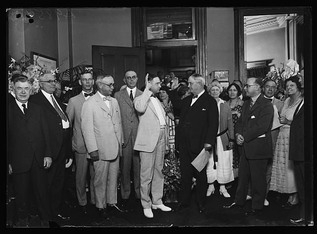[Group at swearing in; includes Hubert Work, center left, and Harry S. New, center right]