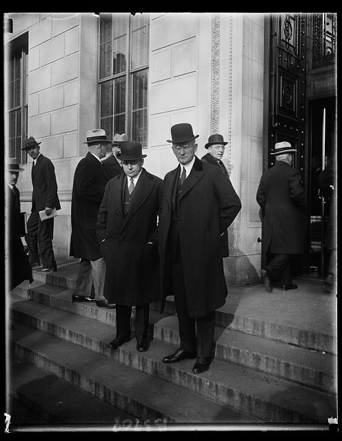 Secretary of Commerce Robert P. Lamont and Assistant Secretary Julius Klein (right) as they left the United States Chamber of Commerce today after attending the open session of the meeting of American business leaders called together by President Hoover