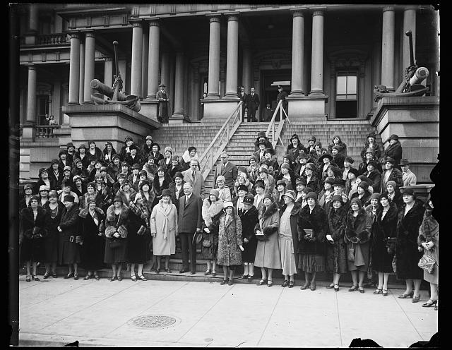Hold annual meeting. The General Federation of Women's Clubs held their annual meeting today at their headquarters, 1734 N Street, N.W. They were photographed with President Hoover on the steps of the State, War, and Navy department. In the group, left to right: Mrs. J.F. Sipple, President of Baltimore, MD., President Hoover and Mrs. Grace Morrison Poole, 1st Vice President of Brocton, Mass.