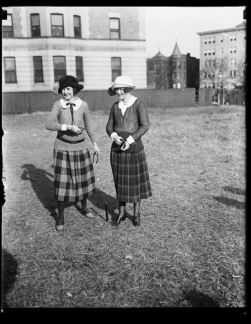 [Debutantes playing horse shoes. Left to right: Elizabeth Beale, Virginia Edwards]