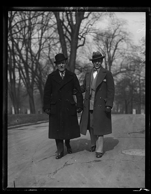 Among the callers at the White House today to see President Coolidge was Sammy Mandell, (right) new Lightweight Champion of the United States, with his Manager Eddie Kane, who also manages Tommy Gibbons