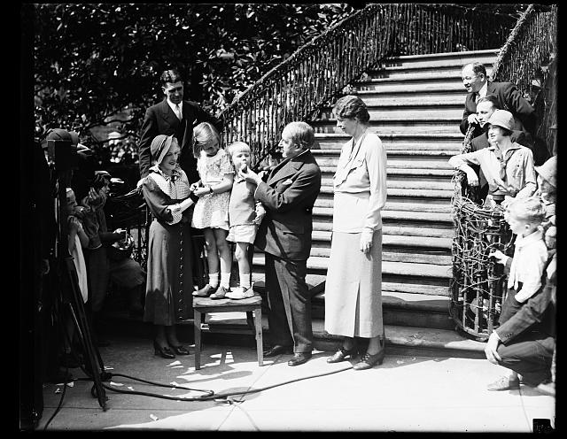SO THAT'S WHERE EGGS COME FROM, AND HOWARD THURSTON, PROFESSIONAL MAGICIAN, PULLS AN EASTER EGG FROM THE MOUTH OF BUZZIE DALL AT THE WHITE HOUSE EGG ROLLING FESTIVALS. THE GROUP, FROM THE LEFT: JANE THURSTON, DAUGHTER OF THE MAGICIAN; SISTIE DALL AND BUZZIE, GRANDCHILDREN OF THE PRESIDENT; MR. THURSTON; AND MRS. ROOSEVELT