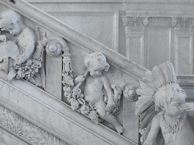 [Great Hall. Detail of putti (Mars and fisherman) and cherub (America) on Grand staircase by Philip Martiny. Library of Congress Thomas Jefferson Building, Washington, D.C.]