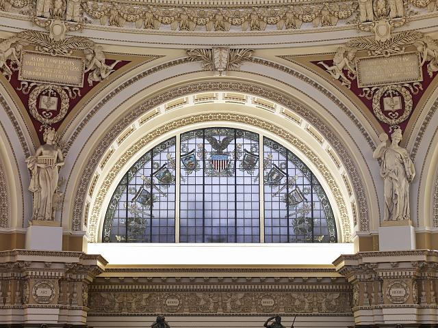 [Main Reading Room. Semi-circular stained glass window in alcove by H.T. Schladermundt with statues of Art and History on either side. Library of Congress Thomas Jefferson Building, Washington, D.C.]